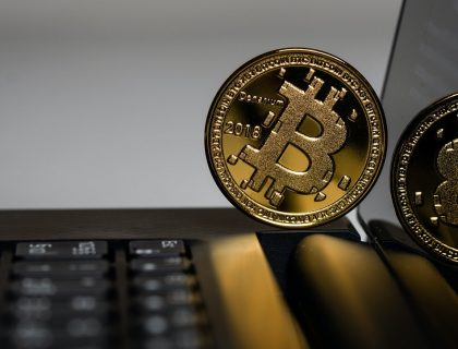 A Bitcoin placed on a Laptop device