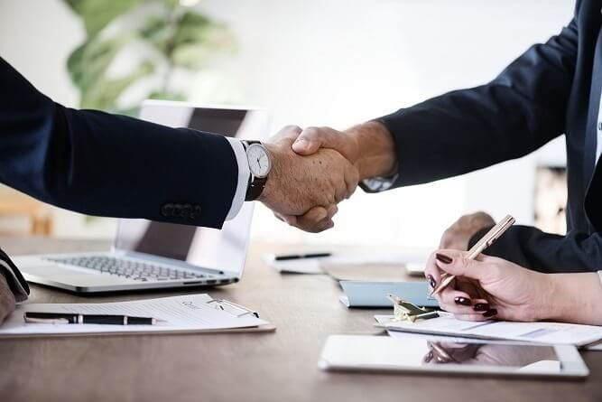 Business owners' meeting and shaking hands