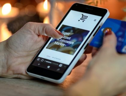 A person using e-commerce app on a smartphone