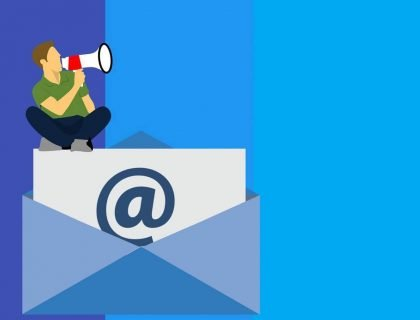 A person sitting on an Email icon doing promotion