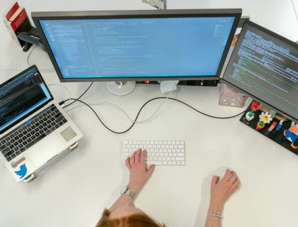 Female software developer doing coding work on her PC