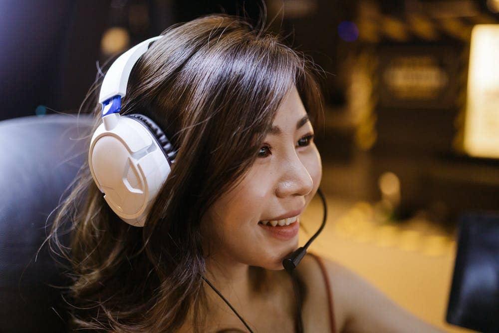 A Gamer Girl Wearing White Gaming Headphones
