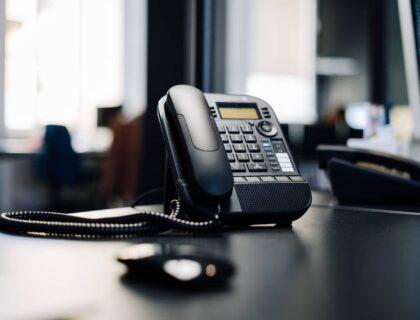 IP phone on a black desk