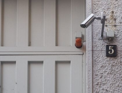 A CCTV camera placed near entrance of a home