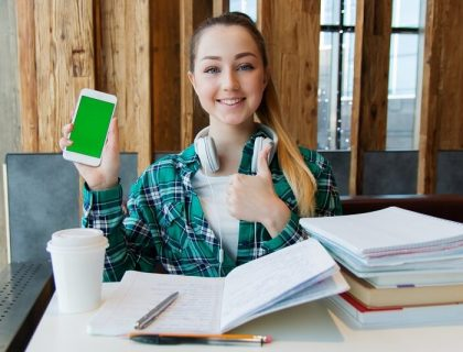 Student using Internet on Smartphone for studying