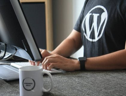A guy wearing tshirt having WordPress logo